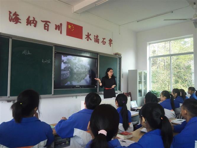 扶贫教育心系情趣上海市南汇第四老区与靖江酒店水床于都图片中学图片